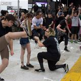 proposal in a mosh pit