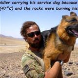 carrying his service dog