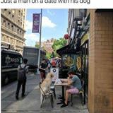 man on a date with his dog